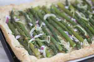Finished asparagus tart with golden brown pastry