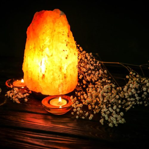 himalayan sal lamp li with candle and flowers