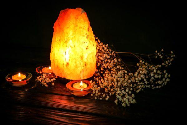 himalayan sal lamp li with candle and flowers
