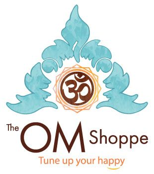 TheOmShoppe logo, tune up your happy. wooden OM symbol in orange flower of life