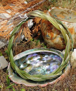 A braided bundle of sweet grass and abalone shell
