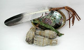 A simple smudge kit with white sage and sweet grass