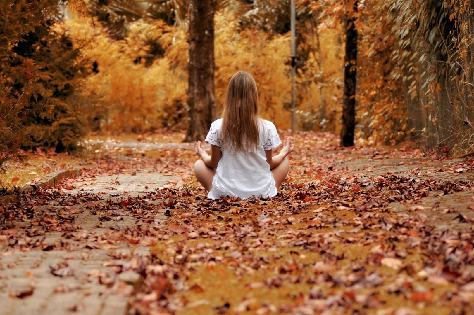 girl meditating fall