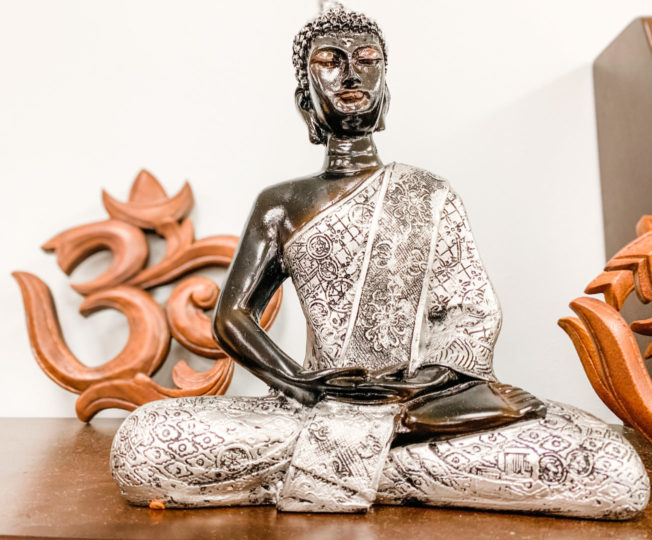 buddha statue as 5 vibrational practices for the waning moon