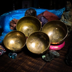 gROUP OF 4 HAND ENGRAVED TIBETAN SINGING BOWLS