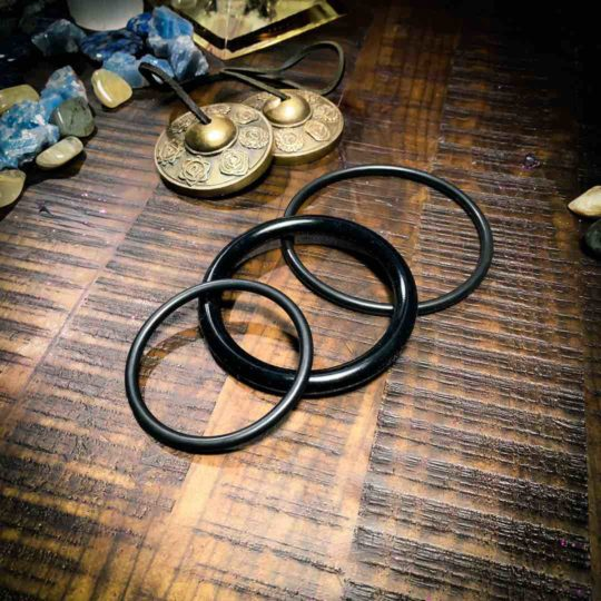 Group of 3 black o-rings at The OM Shoppe & Spa