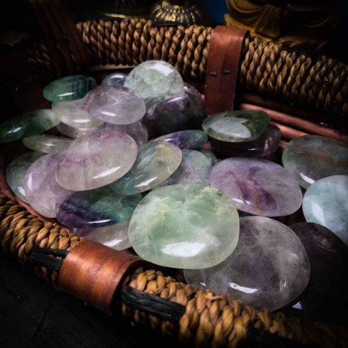 Close-up view of Beautiful smooth tumbled fluorite crystal stones