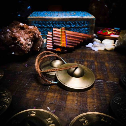tingshas with satin cord and meditation tools