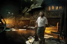 Peter Jackson stands on the set of Lake-Town