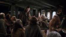 Bard The Bowman (Luke Evans) talks to dwarves in his home.