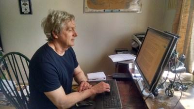 Tim Folger at desk