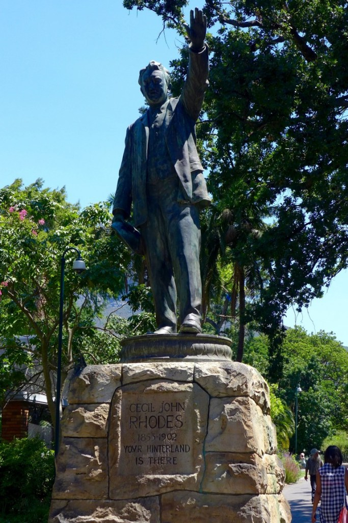 Hire a local tour guide to learn about the history of your destination like the controversy associated with South Africa's Cecil Rhodes