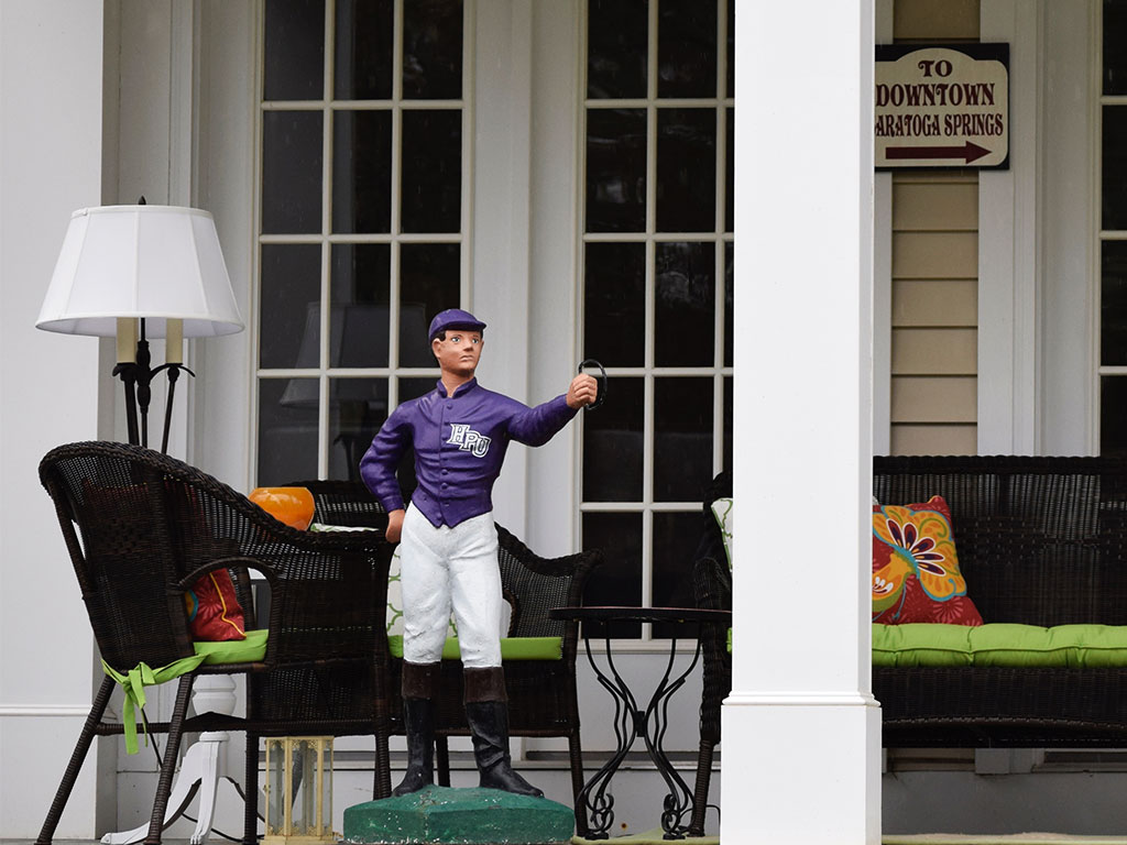 Porch jockey in Saratoga Springs NY - things to do in Saratoga Springs include photographing the great architecture