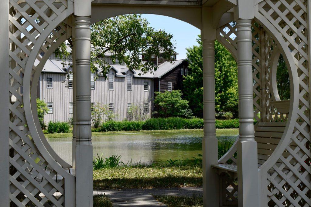 View through a gazebo at the Mackenzie-Childs farmhouse.
