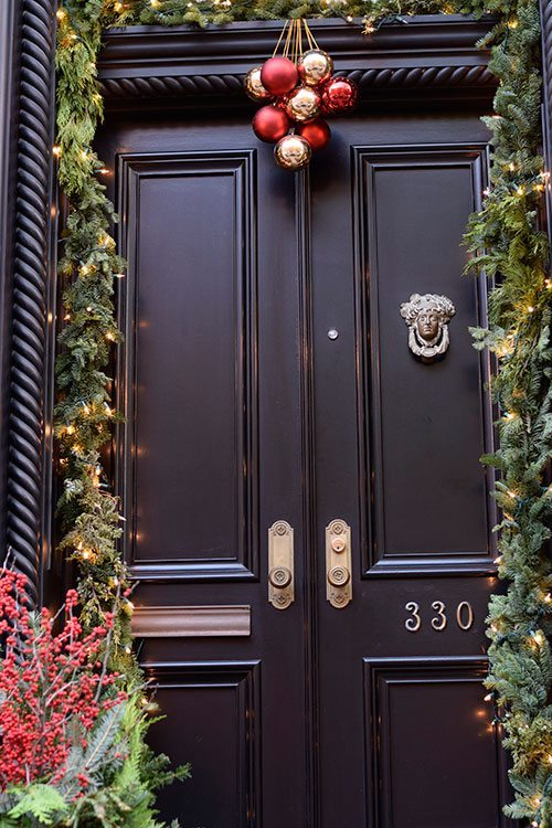 Brownstone door decorated for Christmas in NYC