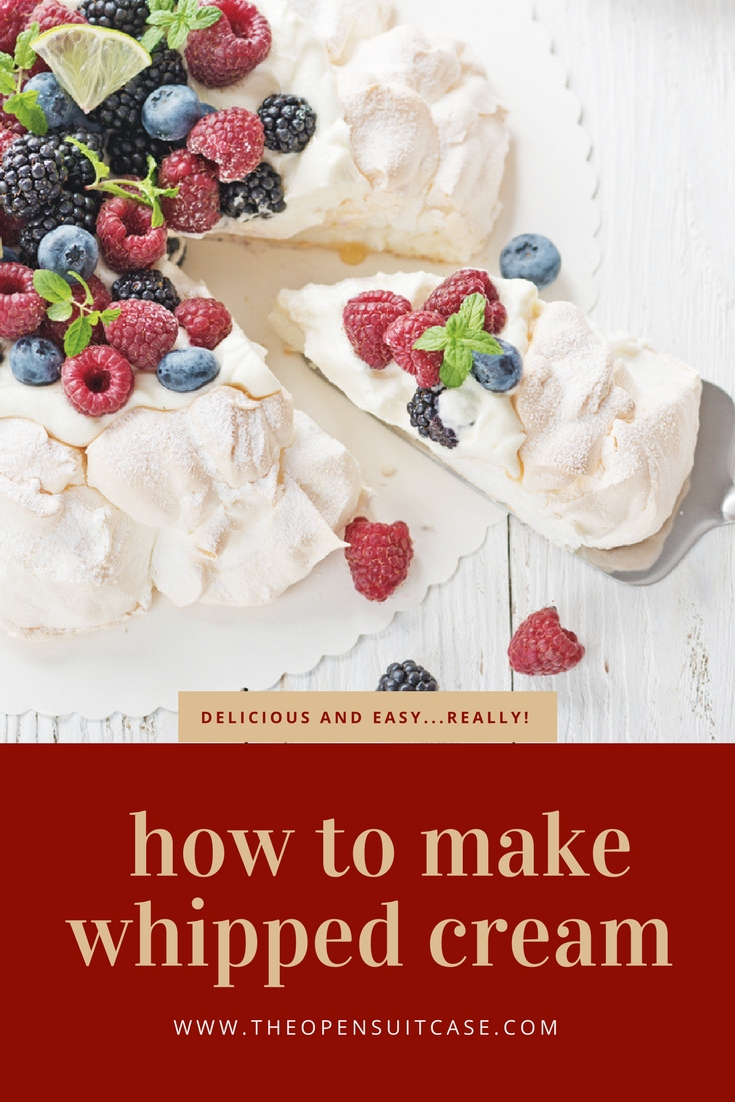 cake decorated with homemade whipped cream and assorted berries - how to make whipped cream