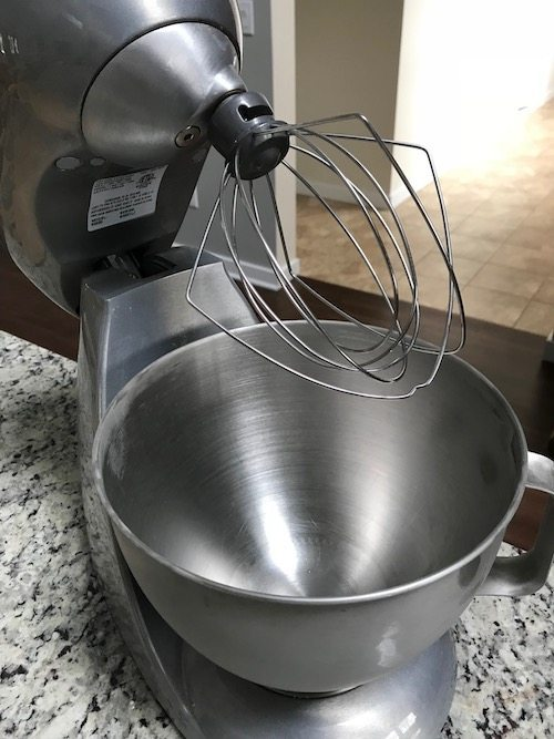 stainless steel stand mixer with empty bowl before using for making whipped cream at home