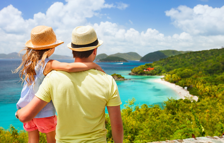 father and daughter looking at beach - fathers day gift ideas for dads who travel