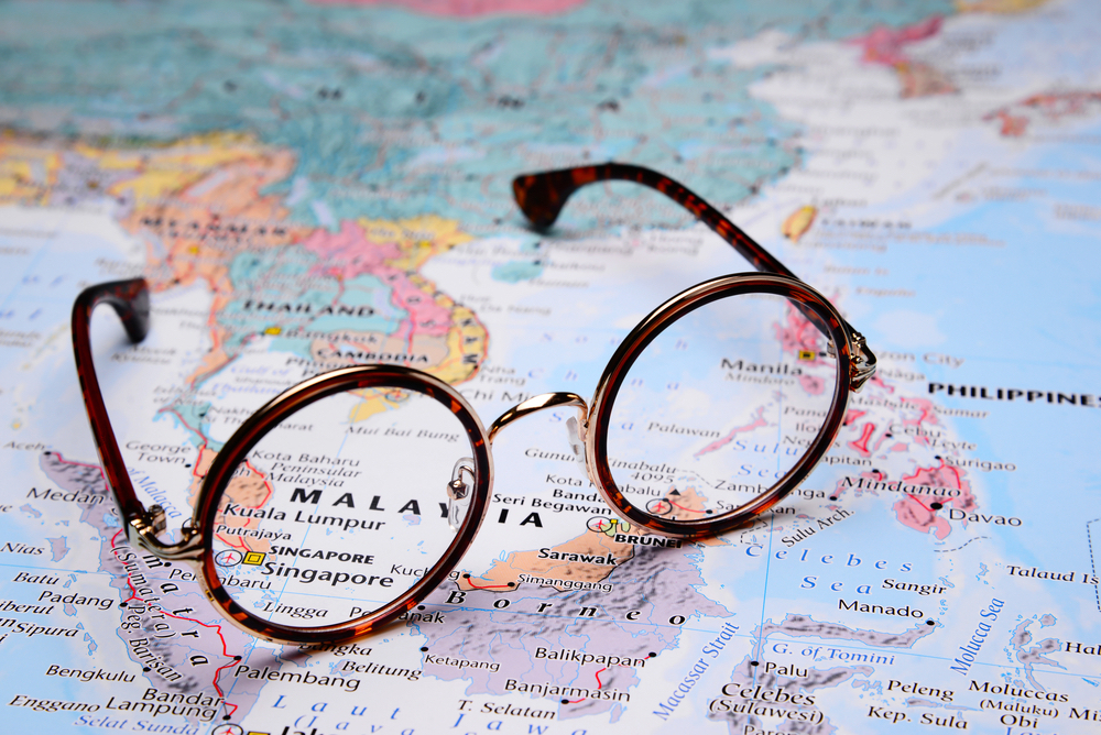 eyeglasses on a map what to do so you don't forget glasses on vacation