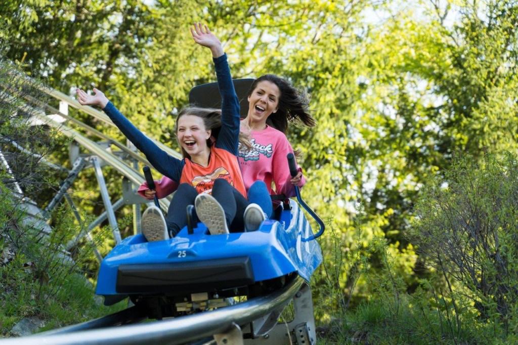 Family enjoying the Alpine coaster at Camelback Resort in spring