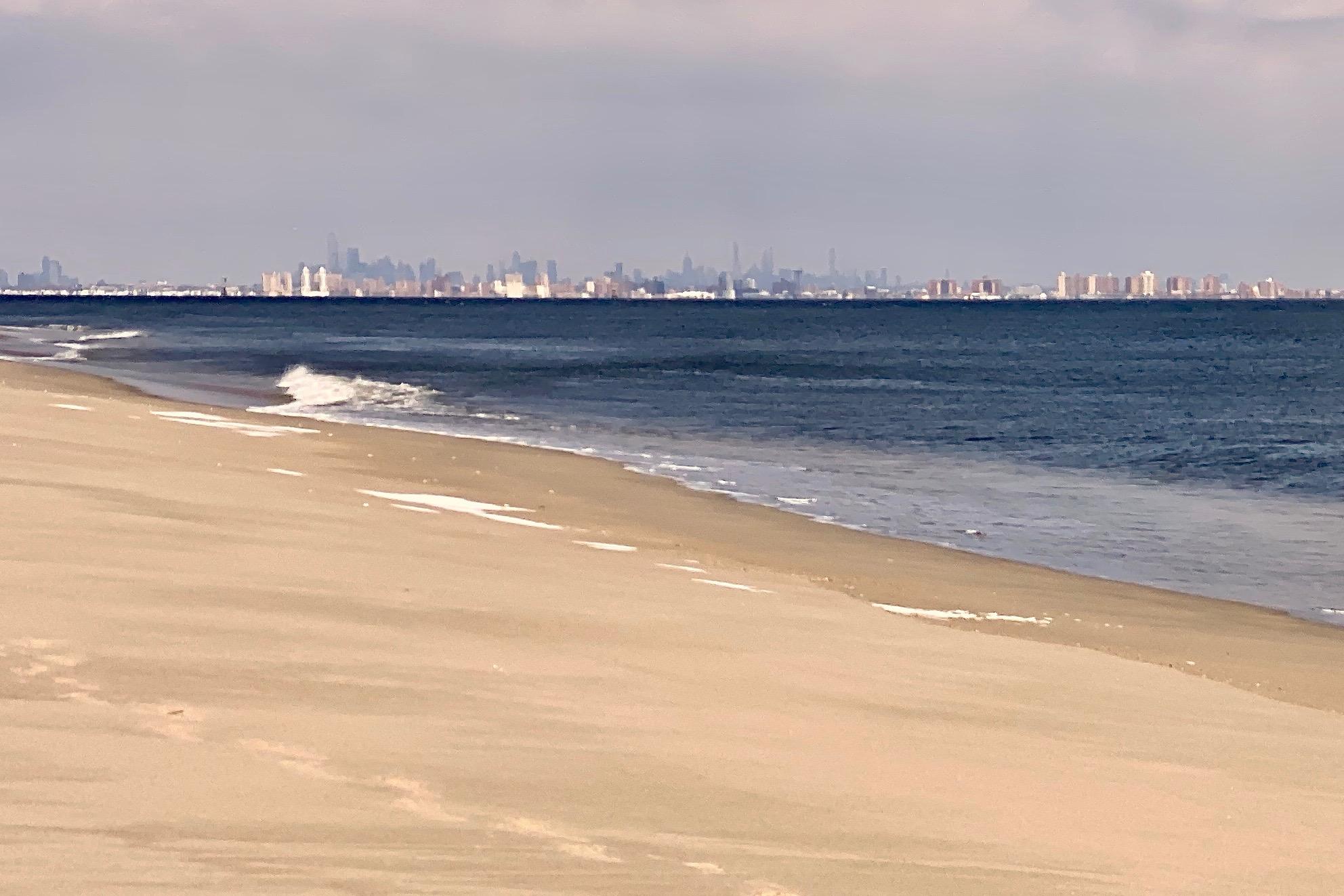 Empty beach and NYC skyline at Sandy Hook, a super east coast beach town