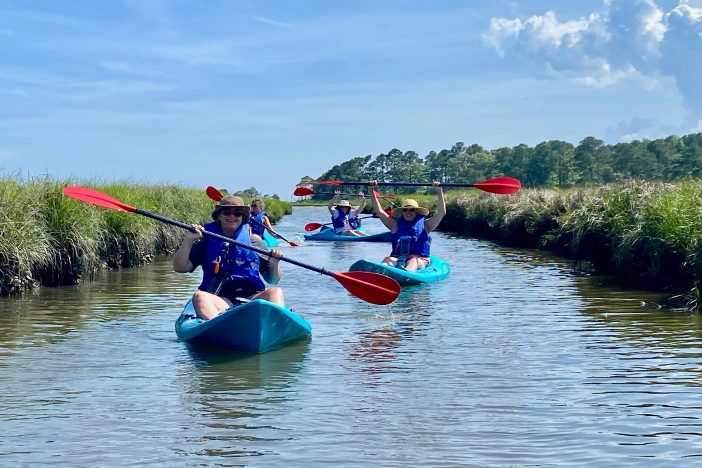 Kayakers in Rehoboth Bay, a fun thing to do in Delaware
