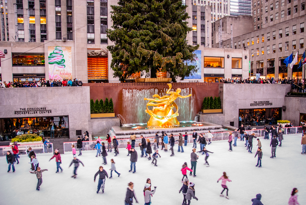 Skaters on the ice rink in front of the Prometheus statue in Rockefeller Center NYC
