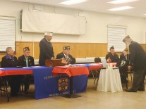 VFW Post 7788 Officers light the candle for the Table for One