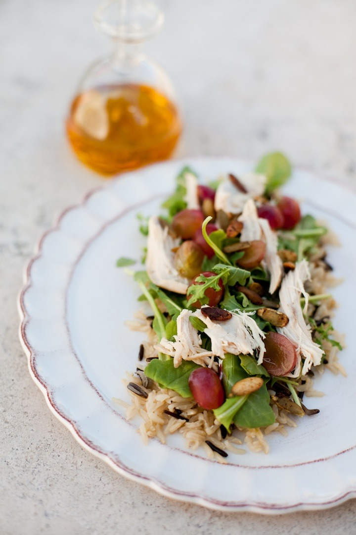 Wild Rice and Arugula Salad with Pear Chardonnay Vinaigrette on white plate set on a marble surface