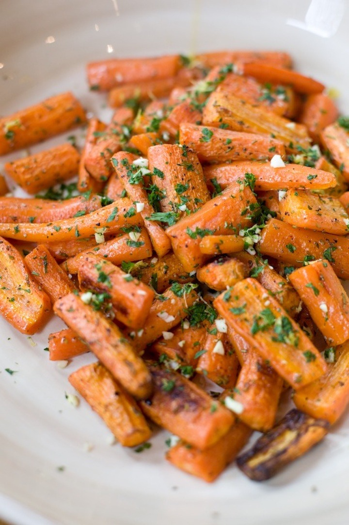 roasted carrots with gremolata in a white bowl