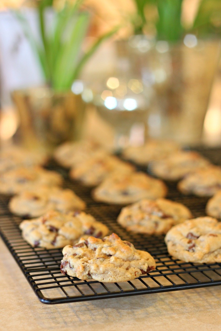 Baked Chocolate Chip Oatmeal Cookies with Orange Glaze on a cooling rack