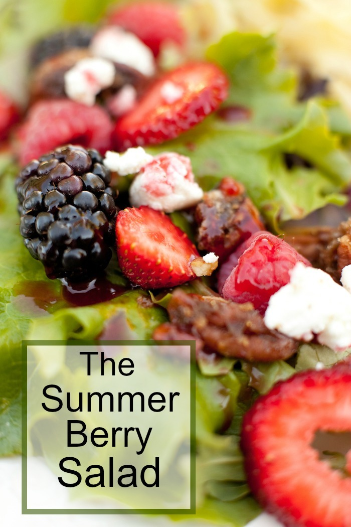 A close ip of my Summer Berry Salad with goat cheese, caramelized nuts, and raspberry vinaigrette