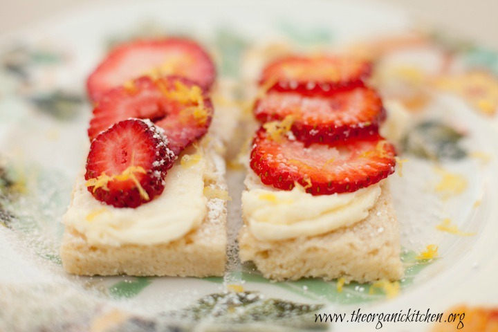 Two Lemon Shortbread Bars with Mascarpone topped with sliced strawberries