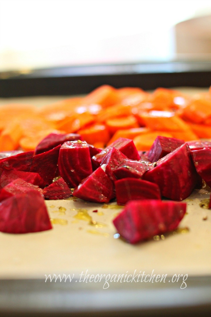 Beets and carrots glistening with olive oil on baking sheet ready to be roasted. Roasted Beet and Carrot Salad with Lemon White Balsamic Vinaigrette