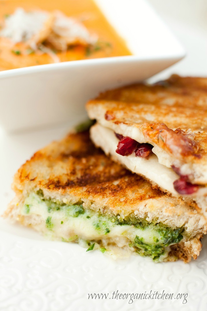 Two grilled cheese sandwiches, one made with fresh basil pesto: How to Make Basil Pesto from The Organic Kitchen