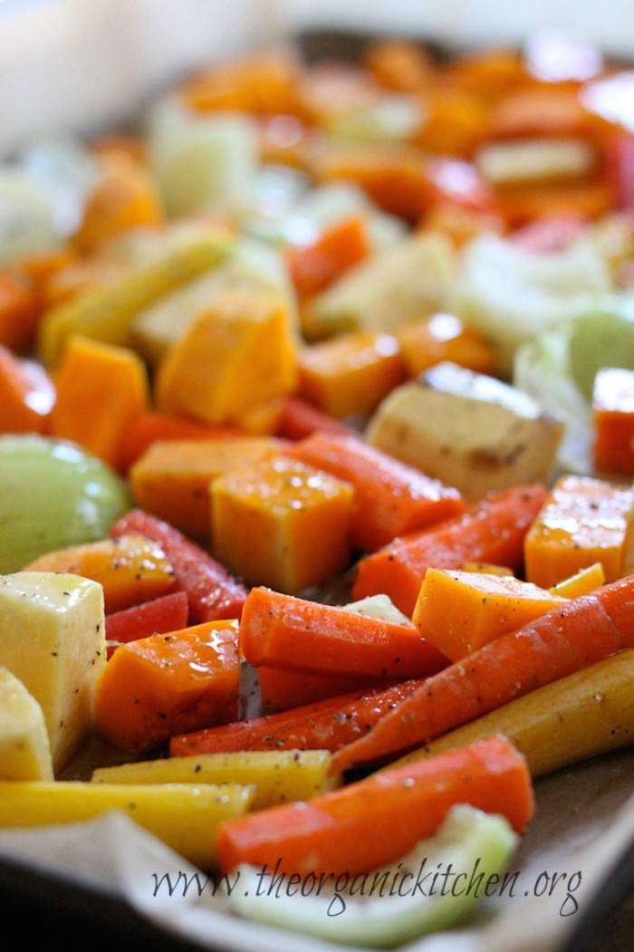 Vegetable drizzled with olive oil on a cookie sheet in preparation for making Roasted Vegetable Soup!
