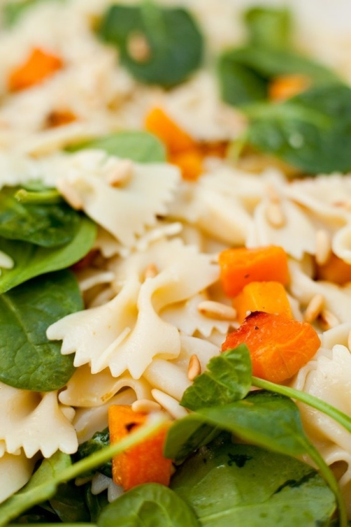A close up of Farfalle with Roasted Butternut Squash and Baby Spinach
