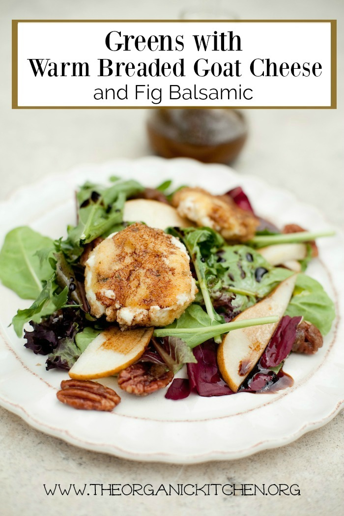 Greens with Warm Breaded Goat Cheese and Fig Balsamic on a white plate with balsamic dressing in the background