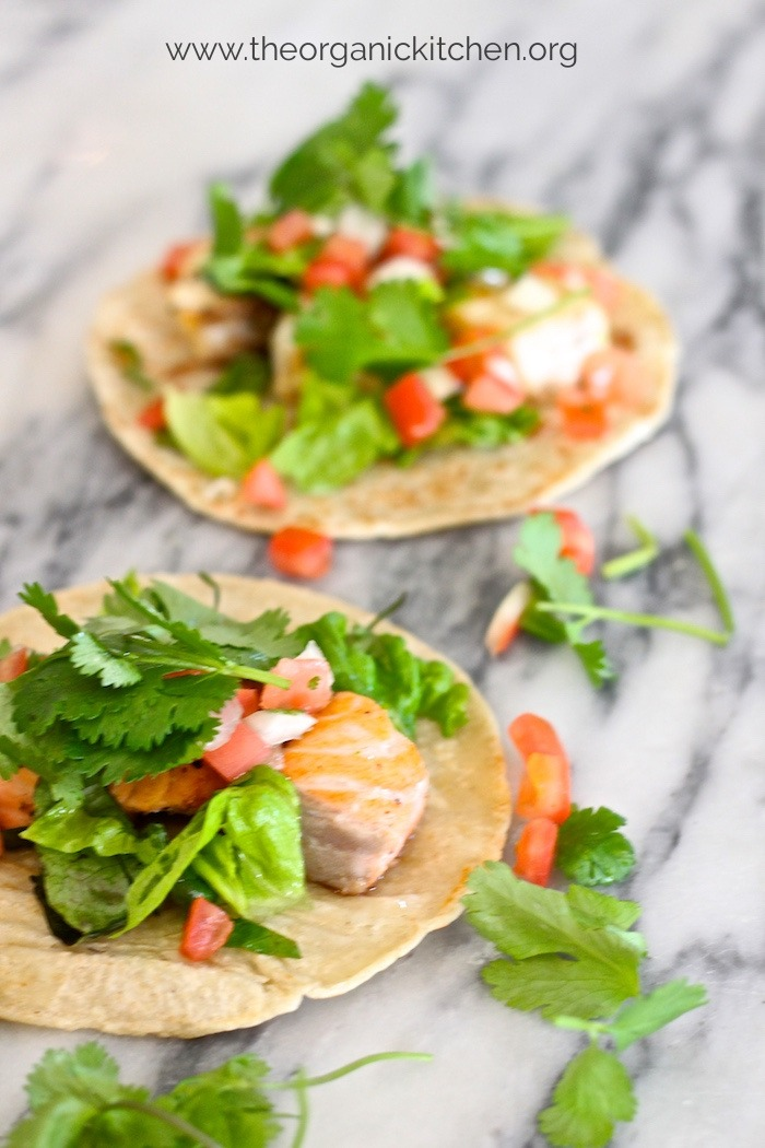 Two Fresh Fish Tacos with fixings on marble surface