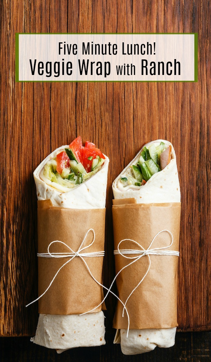 Two veggie wraps tied with parchment and string on wood backdrop: Veggie Wrap~ Five Minute Lunch