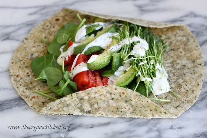 A tortilla loaded with vegetables and ranch dressing on marble surface. Veggie Wrap~ Five Minute Lunch