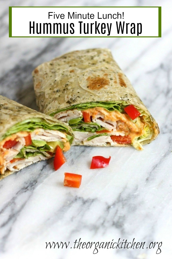 The Hummus Turkey Wrap, cut in half and set on a marble counter