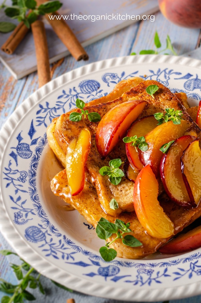 Close up of French Toast with Caramelized Peaches garnished with herbs