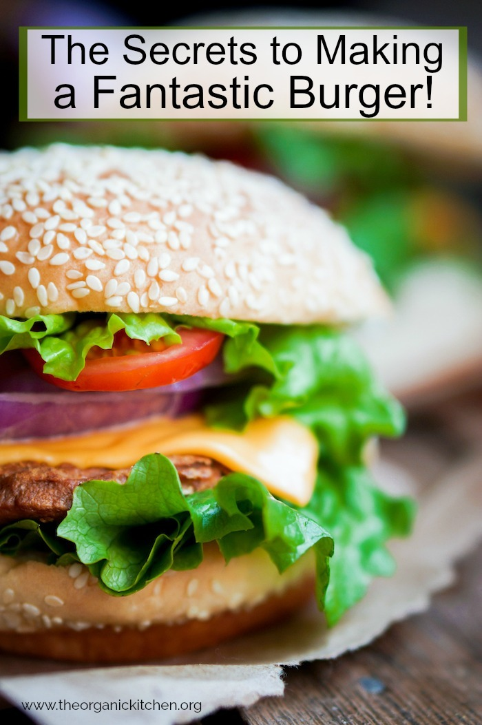 A beautiful burger with lettuce, cheese and onions as part of The Secrets to Making a Fantastic Burger!