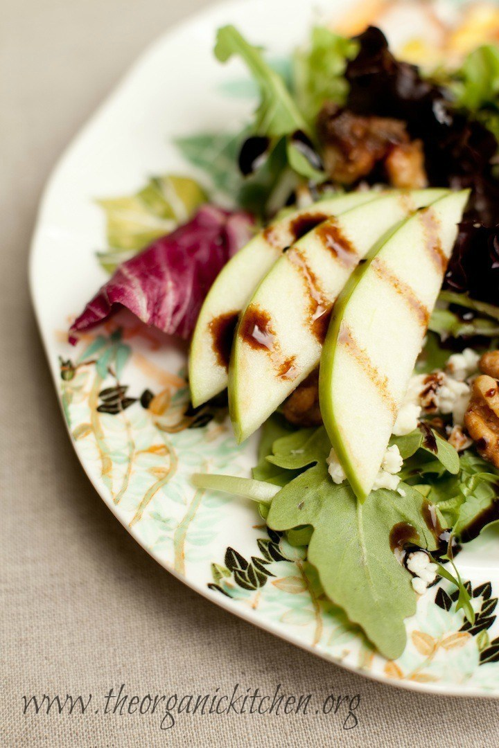 Sliced apples, walnuts and feta cheese atop baby greens and drizzled with balsamic vinaigrette: The House Salad by The Organic Kitchen!