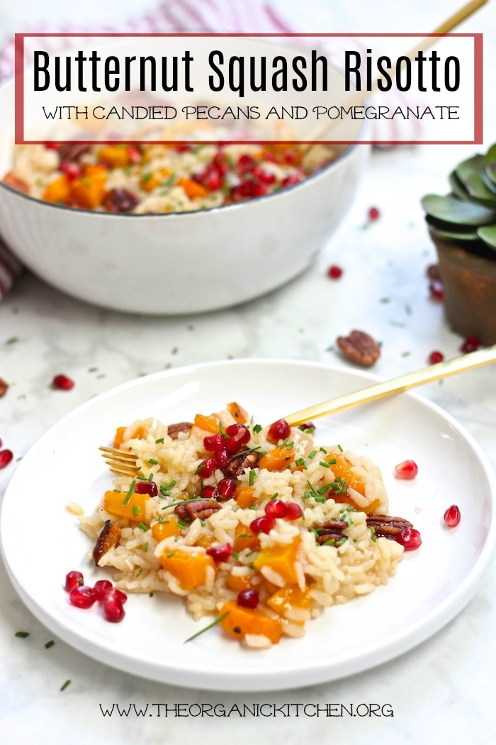Roasted Butternut Squash Risotto with Candied Pecans garnished with pomegranate seeds on white plate with gold forks