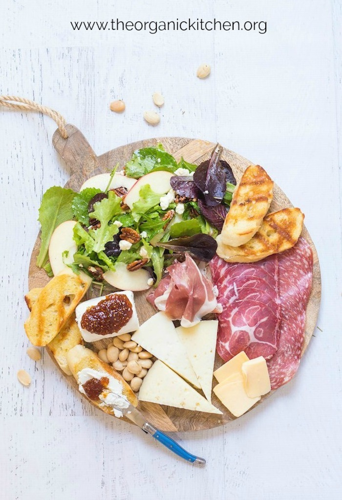 Salad and Charcuterie Board Dinner on white background with scattered almonds