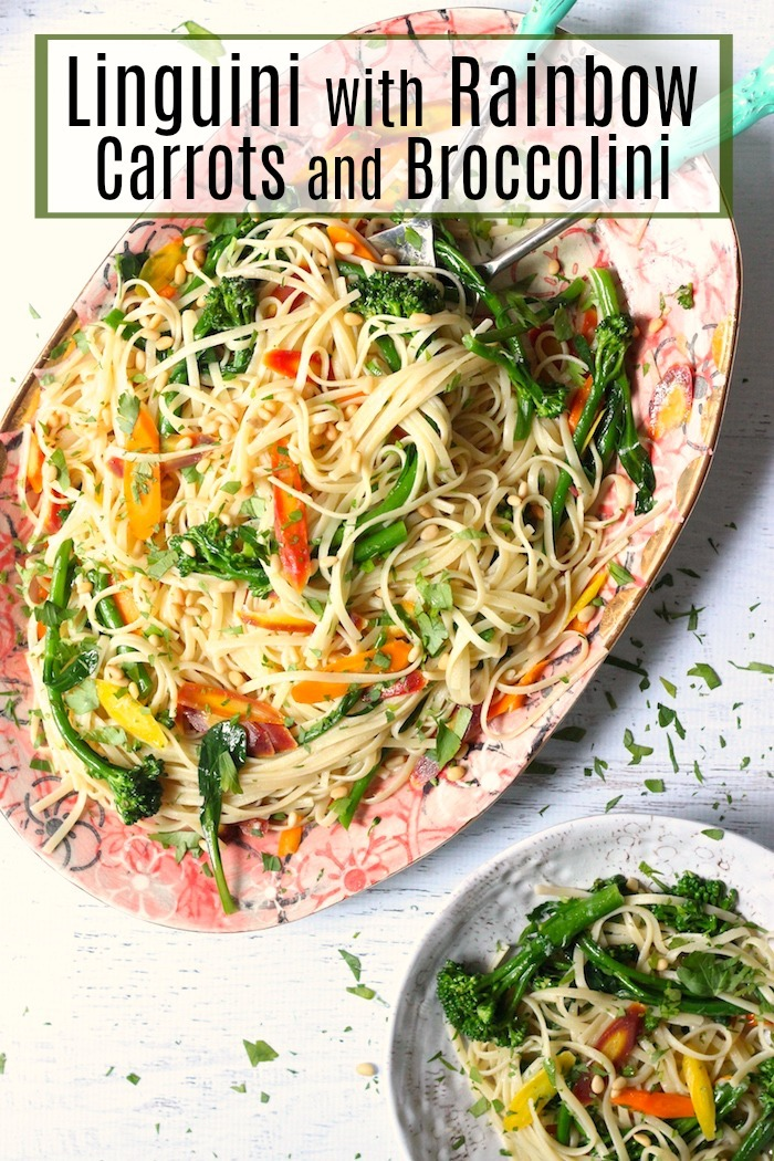 A pink platter overflowing with Linguini with Rainbow Carrots and Broccolini