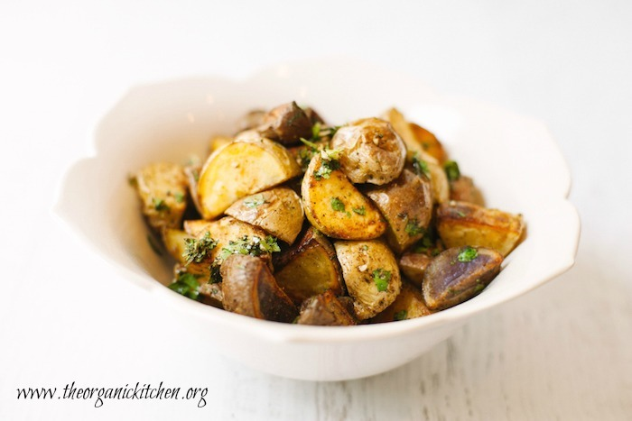 Crispy roasted Mecian potatoes with gremolata in a white bowl