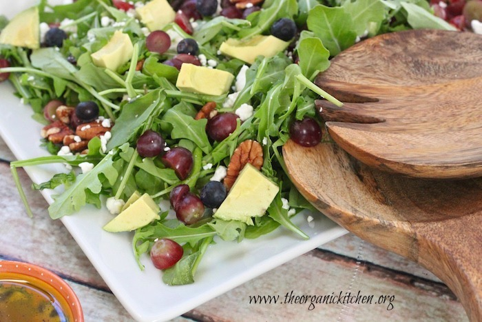 A close up of the Blueberry and Avocado Salad on a white platter